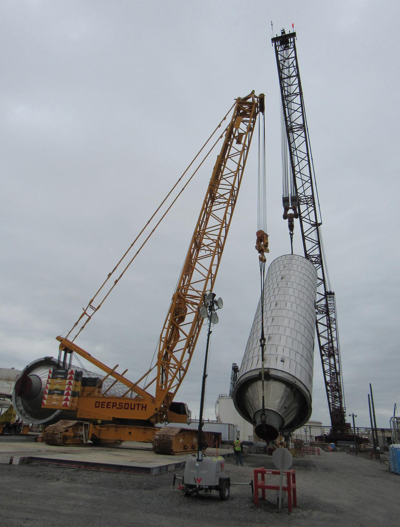 Crane lifting heavy coke drum